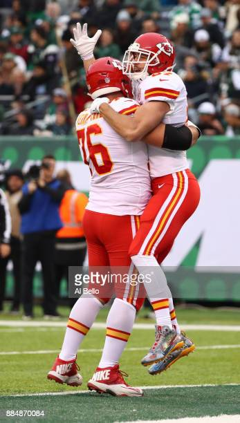 Travis Kelce of the Kansas City Chiefs celebrates with Laurent DuvernayTardif of the Kansas City Chiefs after scoring a touchdown in the first...