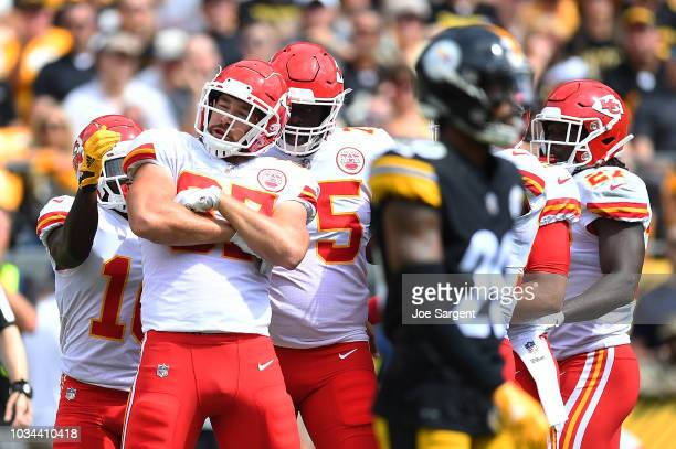 Travis Kelce of the Kansas City Chiefs celebrates with teammates after a 19 yard touchdown reception in the first quarter during the game against the...