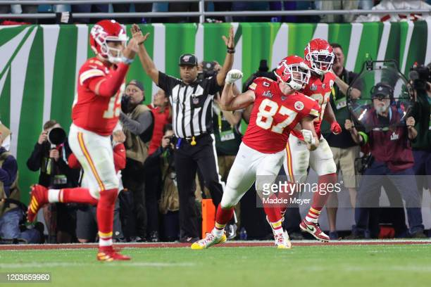 Travis Kelce of the Kansas City Chiefs celebrates with teammates after scoring a touchdown against the San Francisco 49ers during the fourth quarter...