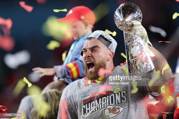 Travis Kelce of the Kansas City Chiefs celebrates with the Vince Lombardi Trophy after defeating the San Francisco 49ers 3120 in Super Bowl LIV at...