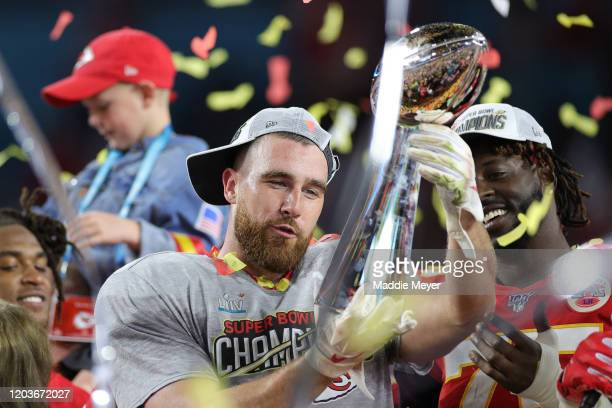 Travis Kelce of the Kansas City Chiefs celebrates with the Vince Lombardi Trophy after defeating the San Francisco 49ers 31-20 in Super Bowl LIV at...