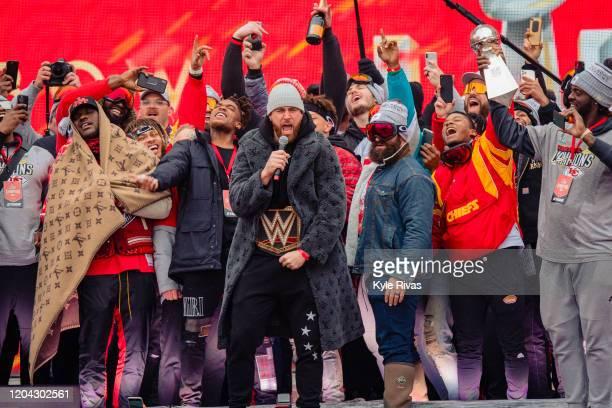 Travis Kelce of the Kansas City Chiefs exhorts fans during the Kansas City Super Bowl parade on February 5 2020 in Kansas City Missouri