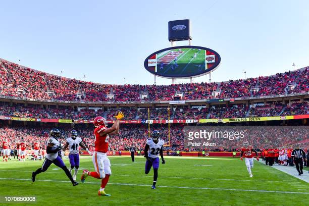 Travis Kelce of the Kansas City Chiefs hauls in the Chiefs second touchdown during the second quarter of the game against the Baltimore Ravens at...
