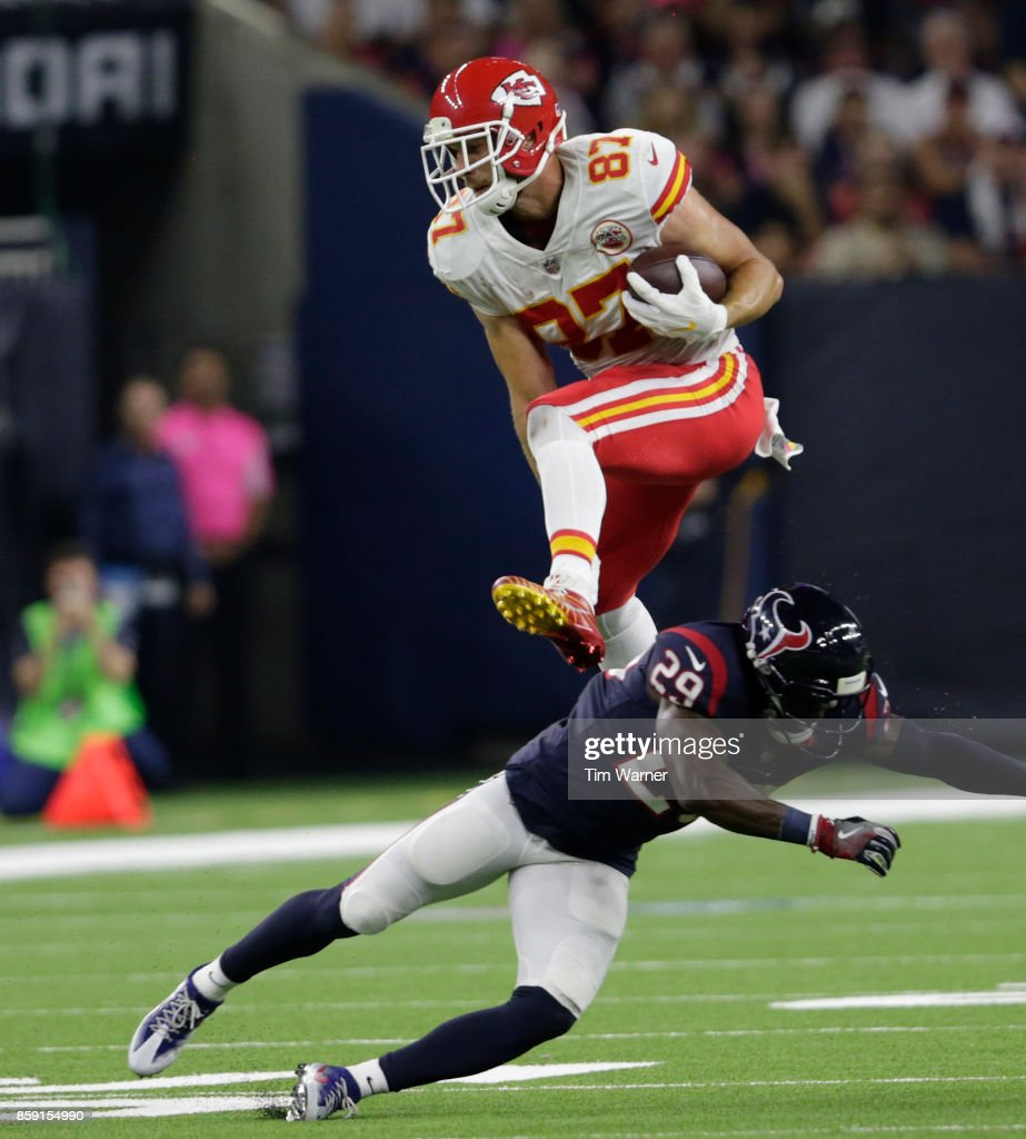 Travis Kelce #87 of the Kansas City Chiefs hurdles Andre Hal #29 of the Houston Texans in the second quarter at NRG Stadium on October 8, 2017 in Houston, Texas.