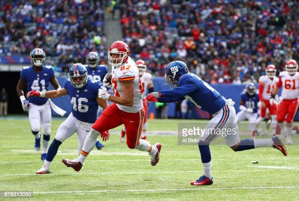 Travis Kelce of the Kansas City Chiefs is hit by Darian Thompson of the New York Giants after a catch during their game at MetLife Stadium on...