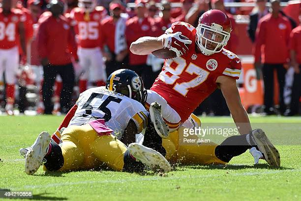 Travis Kelce of the Kansas City Chiefs is tackled by Arthur Moats of the Pittsburgh Steelers at Arrowhead Stadium during the game on October 25 2015...