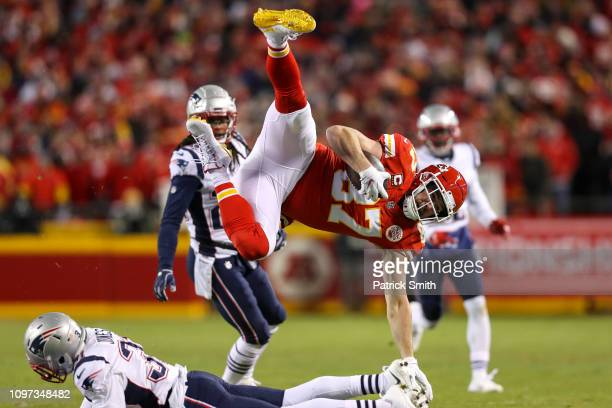 Travis Kelce of the Kansas City Chiefs is tackled by Jonathan Jones of the New England Patriots in the first half during the AFC Championship Game at...