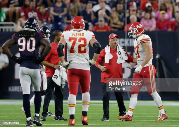 Travis Kelce of the Kansas City Chiefs is tended to by the training staff after an injury in the second quarter against the Houston Texans at NRG...