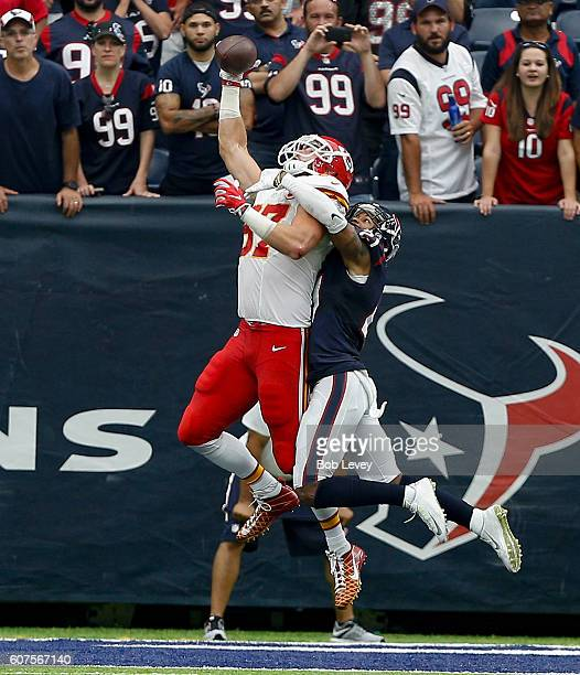 Travis Kelce of the Kansas City Chiefs is unable to make the catch as heis defended by AJ Bouye of the Houston Texans in the fourth quarter at NRG...