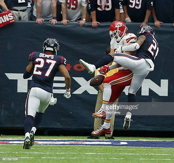 Travis Kelce of the Kansas City Chiefs is unable to make the catch as he is defended by A.J. Bouye of the Houston Texans in the fourth quarter at NRG...