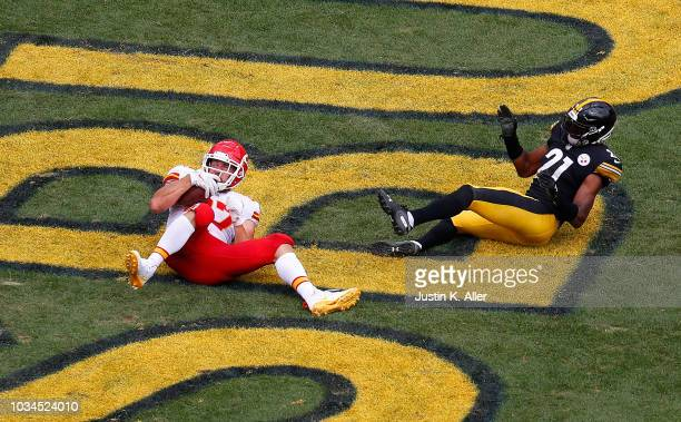 Travis Kelce of the Kansas City Chiefs makes a catch for a 25 yard touchdown reception in the third quarter during the game against the Pittsburgh...