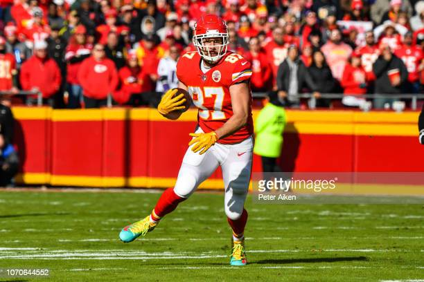 Travis Kelce of the Kansas City Chiefs makes a catch in the open field during the second quarter of the game against the Baltimore Ravens at...