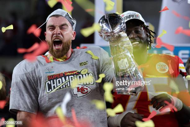Travis Kelce of the Kansas City Chiefs raises the Vince Lombardi Trophy after defeating the San Francisco 49ers 31-20 in Super Bowl LIV at Hard Rock...