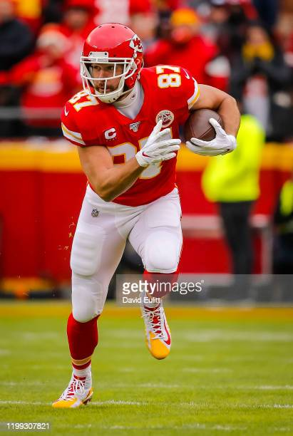 Travis Kelce of the Kansas City Chiefs runs after a pass catch during the first quarter of the AFC Divisional playoff game against the Houston Texans...
