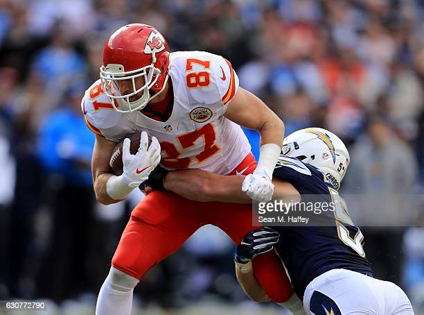 Travis Kelce of the Kansas City Chiefs runs through the defense of Kyle Emanuel of the San Diego Chargers during the first half of a game at Qualcomm...