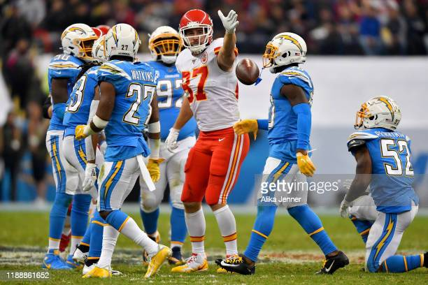 Travis Kelce of the Kansas City Chiefs signals for a first down after fighting for extra yards during an NFL football game against the Los Angeles...
