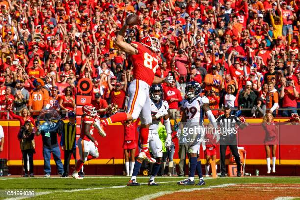 Travis Kelce of the Kansas City Chiefs spikes the ball in the end zone after scoring a touchdown during the second quarter of the game against the...