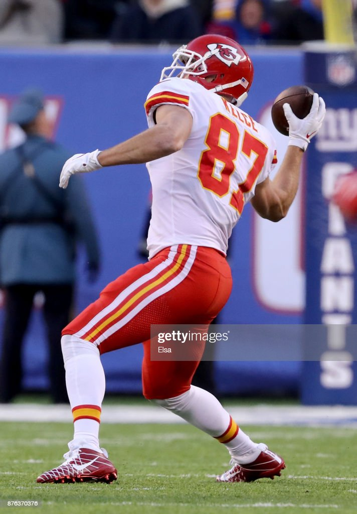 Travis Kelce #87 of the Kansas City Chiefs throws an interception in the second half against the New York Giants on November 19, 2017 at MetLife Stadium in East Rutherford, New Jersey.