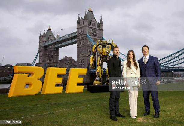 Travis Knight Hailee Steinfeld and John Cena attend a photocall in support of Paramount Pictures' film 'Bumblebee'â at Tower Bridge Potters Field...