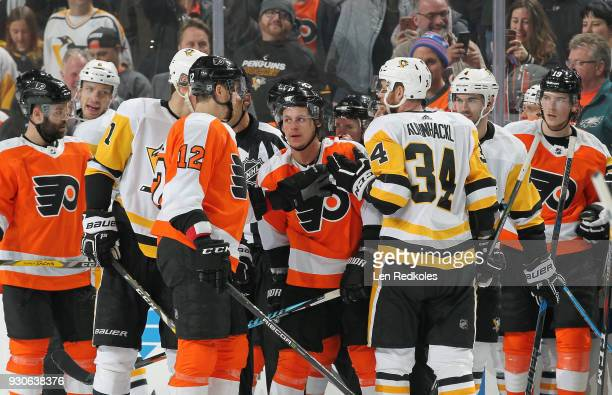 Travis Konecny and Michael Raffl of the Philadelphia Flyers are involved in a scrum with Evegni Malkin and Tom Kuhnhackl of the Pittsburgh Penguins...
