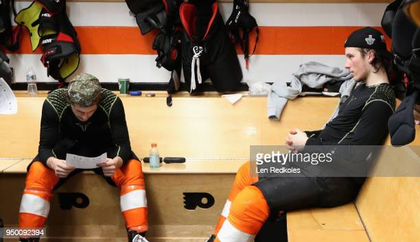 Travis Konecny and Nolan Patrick of the Philadelphia Flyers sit in the locker room after being defeated 85 by the Pittsburgh Penguins in Game Six of...