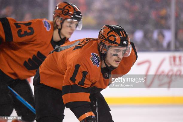 Travis Konecny and Oskar Lindblom of the Philadelphia Flyers line up in position during the 2019 Coors Light NHL Stadium Series game between the...
