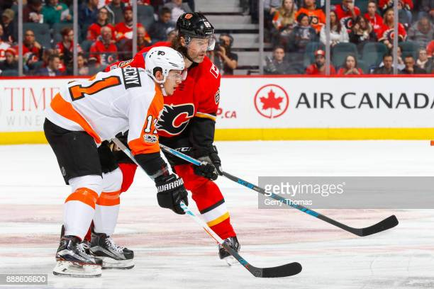 Travis Konecny of the Philadelphia Flyers and Jaromir Jagr of the Calgary Flames at face off in a game against the Philadelphia Flyers at the...