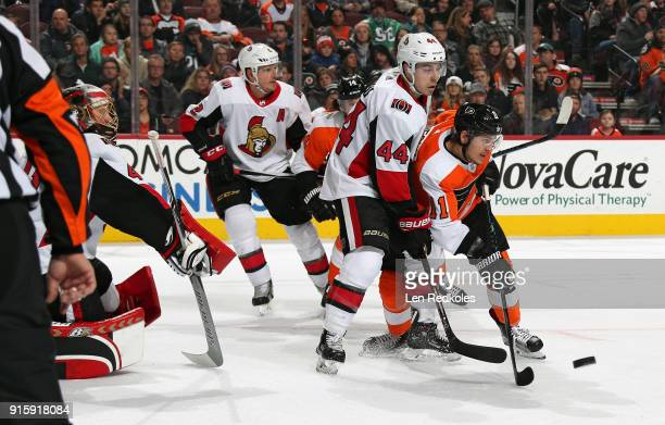 Travis Konecny of the Philadelphia Flyers attempts to deflect a shot on goal against JeanGabriel Pageau Craig Anderson and Dion Phaneuf of the Ottawa...