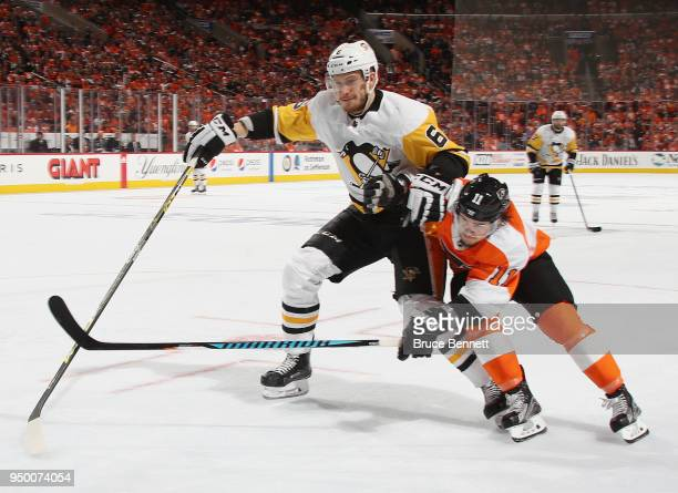 Travis Konecny of the Philadelphia Flyers attempts to get past Jamie Oleksiak of the Pittsburgh Penguins during the second period in Game Six of the...