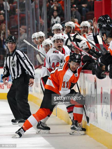 Travis Konecny of the Philadelphia Flyers battles along the boards against JeanGabriel Pageau of the Ottawa Senators on February 3 2018 at the Wells...