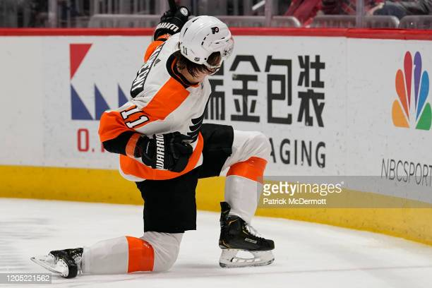 Travis Konecny of the Philadelphia Flyers celebrates after scoring a goal against the Washington Capitals in the second period at Capital One Arena...