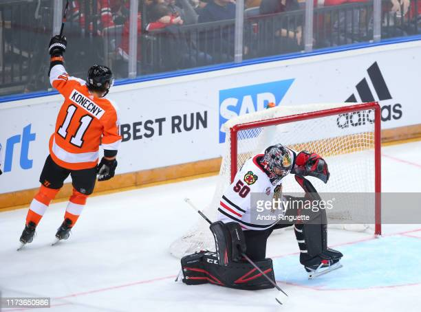 Travis Konecny of the Philadelphia Flyers celebrates his first period goal against Corey Crawford of the Chicago Blackhawks during the Global Series...