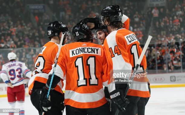 Travis Konecny of the Philadelphia Flyers celebrates his first period goal against the New York Rangers with teammates Claude Giroux Andrew MacDonald...