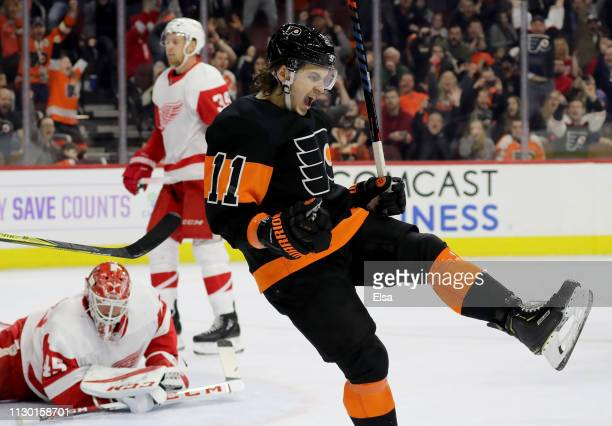 Travis Konecny of the Philadelphia Flyers celebrates his game winning goal as Jonathan Bernier of the Detroit Red Wings reacts at Wells Fargo Center...