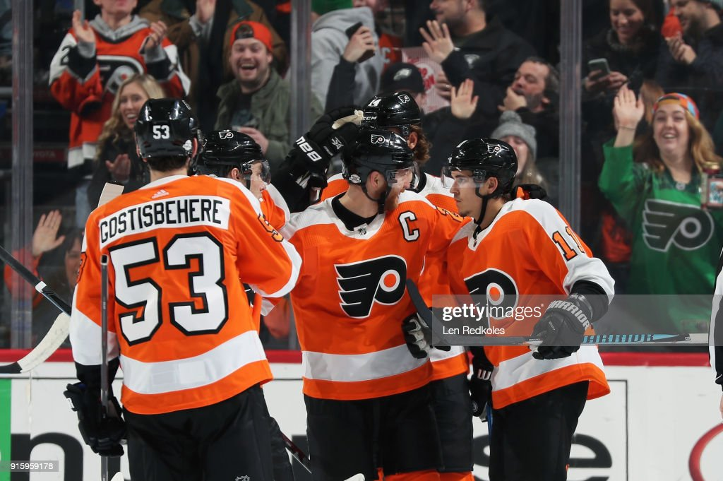 Travis Konecny #11 of the Philadelphia Flyers celebrates his third period goal against the Montreal Canadiens with Shayne Gostisbehere #53, Ivan Provorov #9, Claude Giroux #28, and Sean Couturier #14 on February 8, 2018 at the Wells Fargo Center in Philadelphia, Pennsylvania. The goal was Konecny's second of the game.