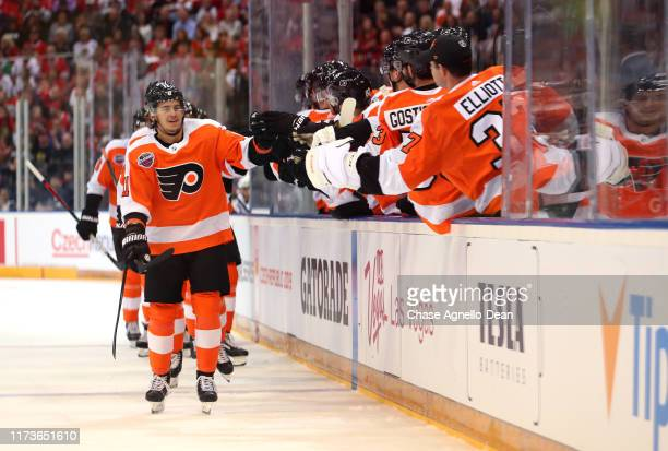 Travis Konecny of the Philadelphia Flyers celebrates with teammates after scoring against the Chicago Blackhawks in the first period of the NHL...