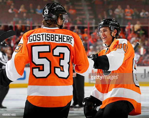 Travis Konecny of the Philadelphia Flyers congratulates Shayne Gostisbehere after Gostisbehere scored his second goal of the game against the New...