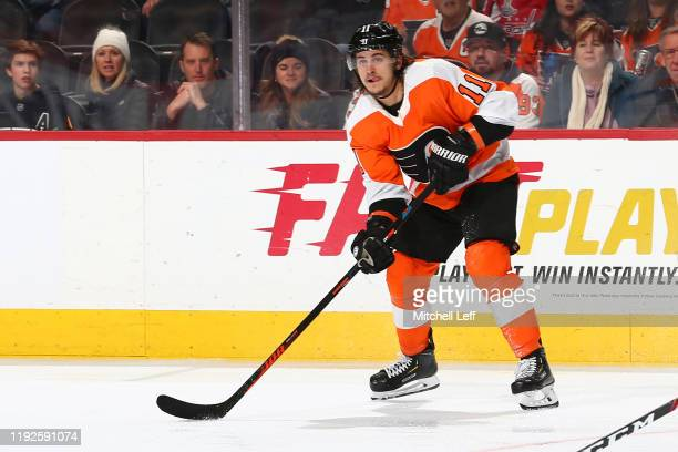 Travis Konecny of the Philadelphia Flyers controls the puck against the Washington Capitals in the third period at the Wells Fargo Center on January...