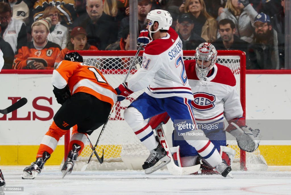 Travis Konecny #11 of the Philadelphia Flyers drives towards the net against David Schlemko #21 and Carey Price #31 of the Montreal Canadiens on February 8, 2018 at the Wells Fargo Center in Philadelphia, Pennsylvania. Konecny would score on the play.