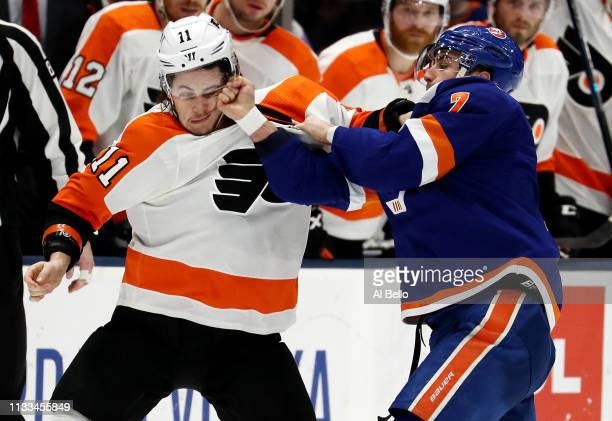 Travis Konecny of the Philadelphia Flyers fights with Jordan Eberle of the New York Islanders during their game at NYCB Live's Nassau Coliseum on...