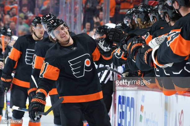 Travis Konecny of the Philadelphia Flyers is congratulated by teammates after scoring a goal in the first period against the New York Rangers at...