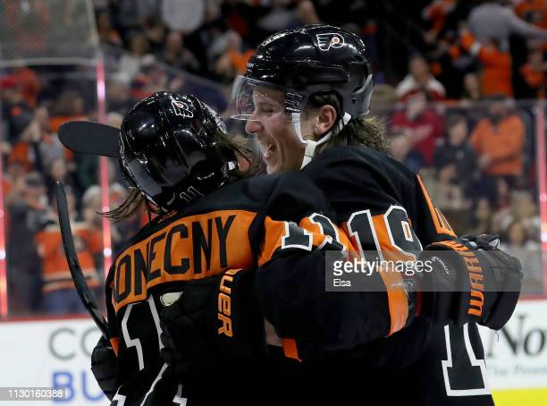 Travis Konecny of the Philadelphia Flyers is congratulated by Nolan Patrick after Konecny scored the game winning goal in overtime at Wells Fargo...