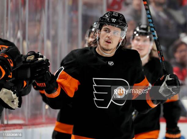 Travis Konecny of the Philadelphia Flyers is congratulated by teammates on the bench after he scored in the second period against the New Jersey...