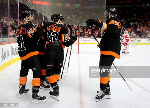 Travis Konecny of the Philadelphia Flyers is congratulated by teammates Scott Laughton,Michael Raffl Wayne Simmonds after Travis Konecny scored the...
