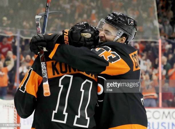 Travis Konecny of the Philadelphia Flyers is congratulated by teammate Shayne Gostisbehere after Konecny scored the game winning goal against the...