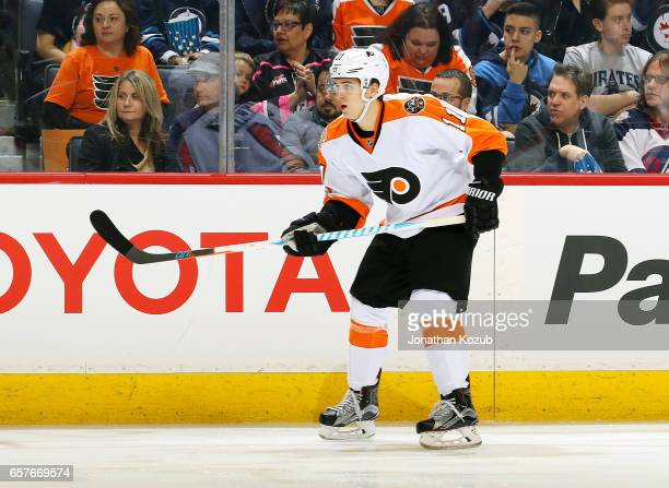 Travis Konecny of the Philadelphia Flyers keeps an eye on the play during second period action against the Winnipeg Jets at the MTS Centre on March...
