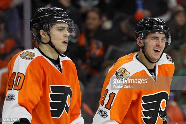Travis Konecny of the Philadelphia Flyers looks on after being hit in the face with a highstick against the Columbus Blue Jackets during the second...