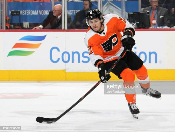Travis Konecny of the Philadelphia Flyers looks to pass the puck against the Florida Panthers on February 10, 2020 at the Wells Fargo Center in...