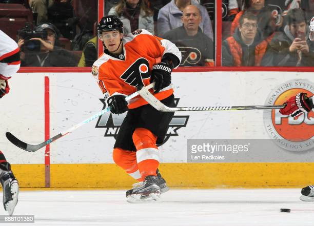 Travis Konecny of the Philadelphia Flyers passes the puck against the New Jersey Devils on April 1 2017 at the Wells Fargo Center in Philadelphia...