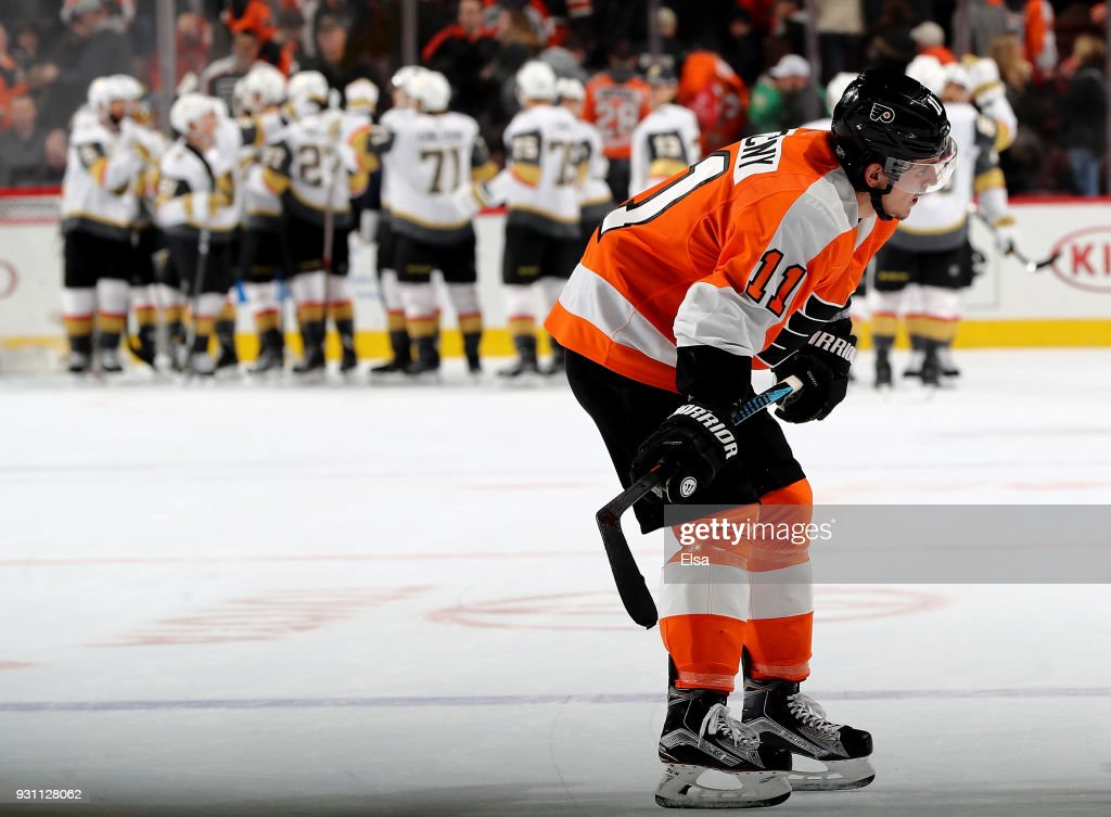 Travis Konecny #11 of the Philadelphia Flyers reacts as the Vegas Golden Knights celebrate the 3-2 over the Philadelphia Flyers on March 12, 2018 at Wells Fargo Center in Philadelphia, Pennsylvania.